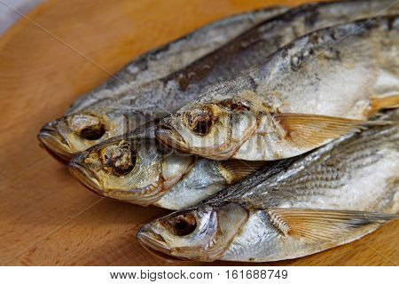 Stockfish sabrefish on the table. Natural food.