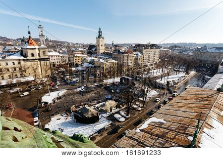 Top view of the Square to Liberdade Avenue and the historical part of Lviv, Ukraine winter day. Above the town rises the Town Hall Lviv, Cathedral Basilica of the Assumption, Jesuit Church.