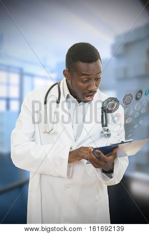 African American doctor shocked and scared by information on a clipboard