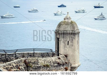 small watch tower above ocean in monaco