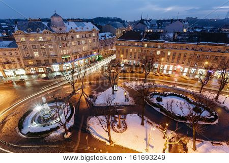 Lviv, Ukraine - February, 2014 - top view Mari Square and Liberty Square on the avenue in the winter evening in Lviv, Ukraine.