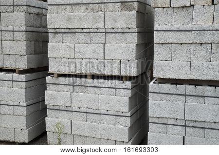 Several pallets of gray concrete blocks closeup