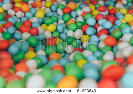 Pile of delicious colorful milk chocolate candies with thin crisp shell