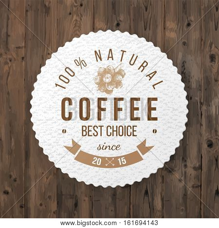 Round paper coffee emblem with type design and hand drawn coffee plant
