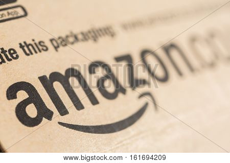 Paris France - December 15 2016: Amazon Prime Parcel Package. Amazon is an American electronic commerce and cloud computing companybased in Seattle Washington. Started as an online bookstore Amazon is become the most importrant retailer in the United Stat