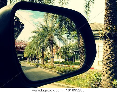 Abstract image of the road on car side view mirror