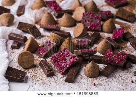 Different varieties of chocolate: dark chocolate milk chocolate chocolate truffles
