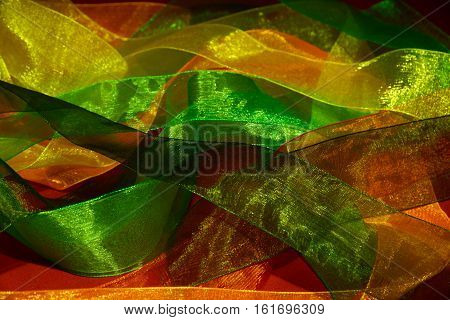 Multicolored translucent ribbons scattered randomly. Background texture