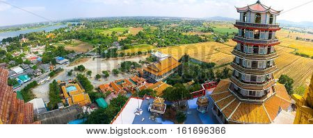 Tiger Cave Temple (Wat Tham Sua) ,Kanchanaburi, Thailand. The view is really outstanding with Mae Klong River and green color of gigantic rice fields.