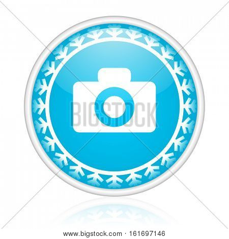 Photo camera vector icon. Winter and snow design round web blue button. Christmas and holidays pushbutton.