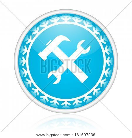 Tools vector icon. Winter and snow design round web blue button. Christmas and holidays pushbutton.
