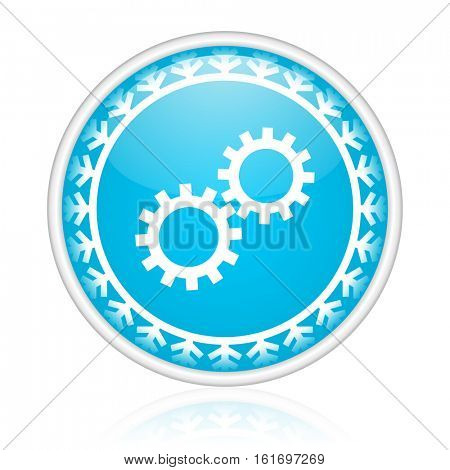 Gears vector icon. Winter and snow design round web blue button. Christmas and holidays pushbutton.