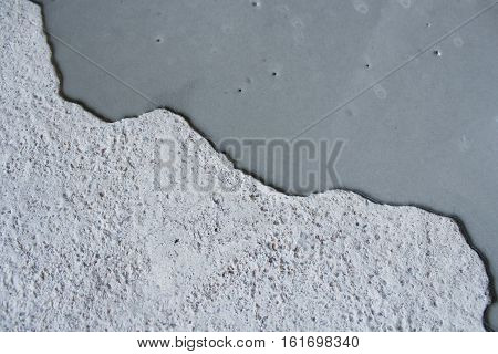 Concrete background.  Self leveling compound spreading .