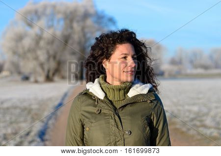 Pretty Woman Walking Along A Frosted Rural Road