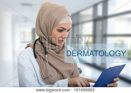 portrait of worried muslim female Medical doctor holding paperclip in hospital. Dermatology sign