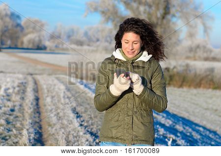 Pretty Woman Texting On A Cold Winter Morning