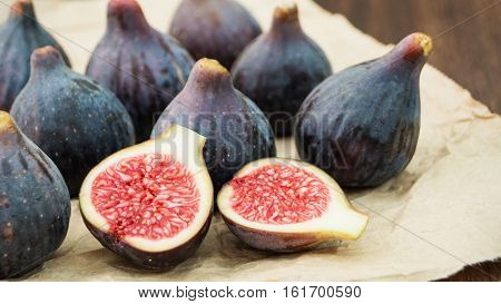 Fresh figs fruits on rustic background. Pile of ripe figs selective focus horizontal
