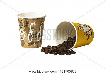 On a white background a paper cup of coffee is the second lie. From lying scattered cup of coffee beans.