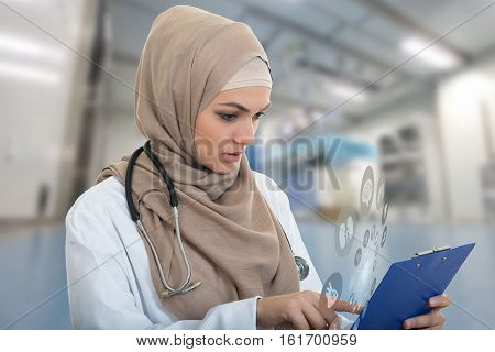 portrait of worried muslim female Medical doctor holding paperclip in hospital. HIPPA sign