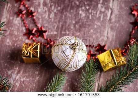 Christmas ball, gift boxes, bijouterie and fir tree branch