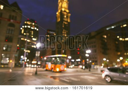 evening downtown Boston. blurred background due to the concept