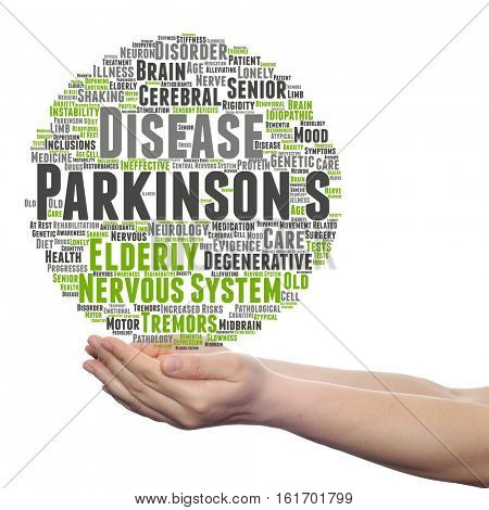 Concept or conceptual Parkinson`s disease healthcare or nervous system disorder abstract word cloud held in hands isolated on background