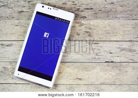 BUNG KAN THAILAND - SEPTEMBER 02 2015: smartphone on the table and facebook on screen