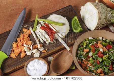 glued chopped fresh vegetables on kitchen board