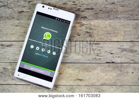 BUNG KAN THAILAND - SEPTEMBER 02 2015: smartphone on the table and whatsapp on screen