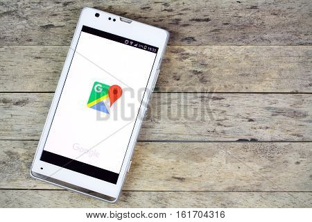 BUNG KAN THAILAND - SEPTEMBER 02 2015: smartphone on the table and google map on screen