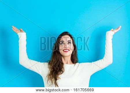 Woman Reaching And Looking Upwards