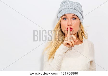 Happy Young Woman Making A Quiet Gesture