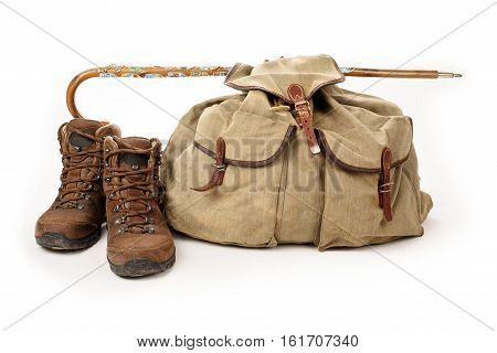 Hiking equipment shoes and backpack isolated on white background