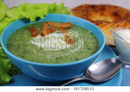 vegetarian cream soup with sour cream and croutons