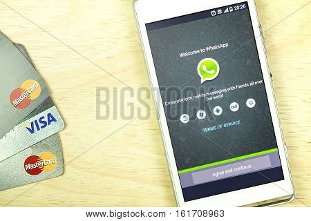 BUNG KAN THAILAND - JANUARY 15 2016: smart phone display whatsapp app and credit card on office desk