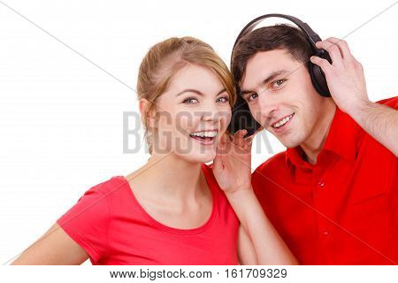 Couple two friends with big headphones listening to music mp3 together. Joyful happy woman and man on white. People leisure happiness concept.