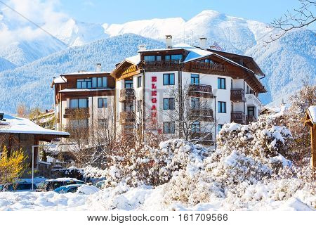 Bansko, Bulgaria - November 30, 2016: Elegant Lux hotel and snow mountains panorama in bulgarian ski resort Bansko