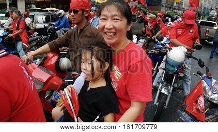 BANGKOK THAILAND - JANUARY 232011: Mother and daughter on the Red Shirt demonstration