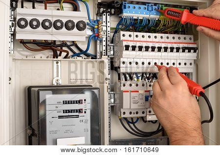 Men is working on a Fuse box