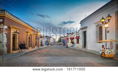 OAXACA, MEXICO-DEC 10, 2015: Street of Oaxaca by night on Dec 10, 2016, Mexico. The city architecture of Oaxaca is protected by UNESCO