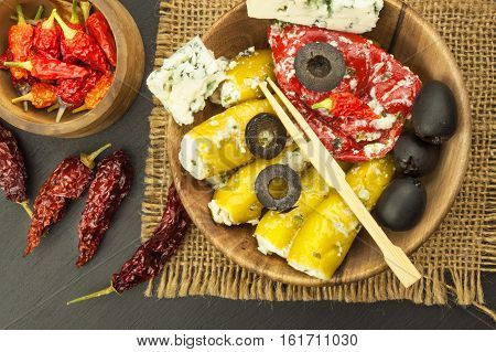 Dried chillies and spicy peppers filled with cheese. Delicacy suitable for grilled meats. Chillies and cheese. Advertising on spicy delicacies.