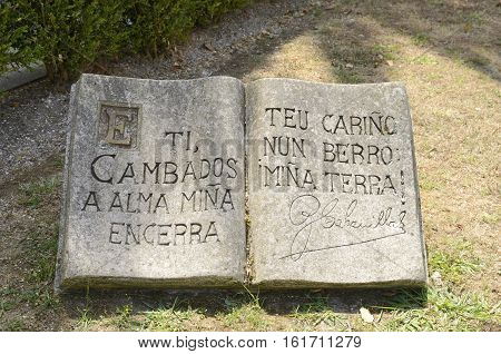 CAMBADOS, SPAIN - AUGUST 8, 2016: Inscription in stone book by the poet Cabanillas that says