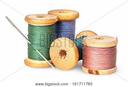 Needle and multicolored thread on wooden spool isolated on white background