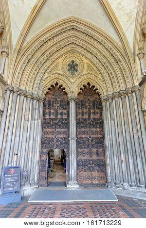 ELY, ENGLAND - JUNE 28, 2016: Main Entrance of Ely Cathedral - the great West Door. The only UK building recognized as one of the Seven Medieval Wonders of the world.