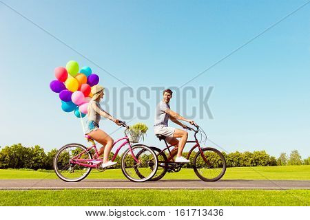 Happy Family Having Summer Weekend And Riding Bicycles