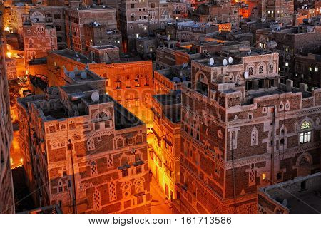 Yemen. Night view of the old city of Sanaa from above. Inhabited for more than 2.500 years at an altitude of 2.200 m the Old City of Sanaa is a UNESCO World Heritage City now destroyed by the civil war