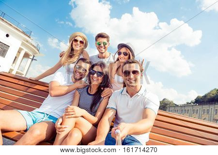Group Of People At Summer Holidays Making Photo With Selfie Stick