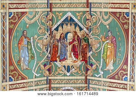 ELY, ENGLAND - JUNE 28, 2016: The sixth panel of the nave ceiling of Ely Cathedral - the Marriage of Ruth a story of a woman who protects her dead husband's mother and is faithful to the God of Israel.