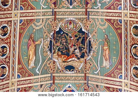 ELY, ENGLAND - JUNE 28, 2016: The fifth panel of the nave ceiling of Ely Cathedral - the Jacob's Dream - God meets with Jacob accompanied by a whole company of angels.