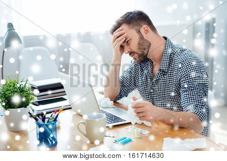 Sick Businessman With Temperature And Headache Working On Xmas